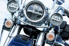 Motorcycle headlight and fog equipment on a light background. Daylight royalty free stock images
