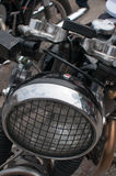 Motorcycle Headlight with a grill stock image