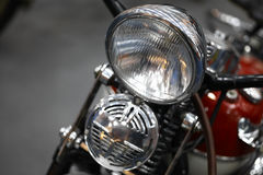 Motorcycle headlight and horn Stock Photos