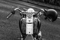 Motorcycle with helmet black and white Stock Photography