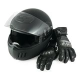 Motorcycle helmet and gloves. Black flip-up motorcycle helmet and leather gloves with carbon fiber protection Stock Photography