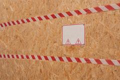 Danger Sign on a wooden plate Royalty Free Stock Photos