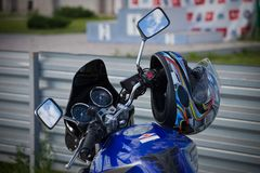 Motorcycle helmet hanging on the handlebars royalty free stock images
