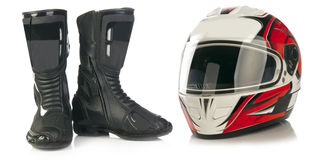 Motorcycle helmet and leather boots Stock Images