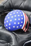 Motorcycle helmet with Stars and Stripes. Helmet with Stars and Stripes design on a motorbike Stock Images