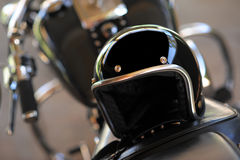 Motorcycle and helmet. Vintage style motorcycle and helmet Royalty Free Stock Photos