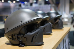 Motorcycle helmets on display stock photos