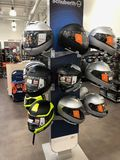 Motorcycle Helmets. On display for sale at a Motorcycle store located in Gilbert Arizona Stock Photo