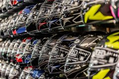 Motorcycle helmets displayed on a wall of a motorsports retailer. Motorcycle helmets are displayed on a wall of a motorsports retail facility Stock Image