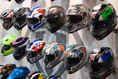 Motorcycle helmets at EICMA 2013 in Milan, Italy Stock Image