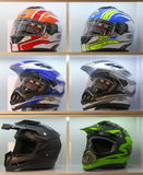 Motorcycle helmets. Modern motorcycle helmets are placed in a showcase at the exhibition in Expoforum. Saint-Petersburg, Russia Stock Photo