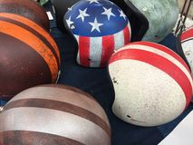 Motorcycle helmets. Several old fashioned motorcycle helmets Stock Image