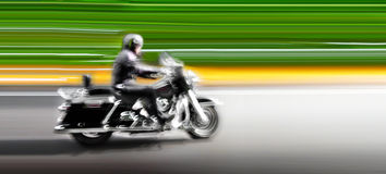 Motorcycle on the highway. Abstract background. Stock Photography