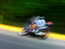 Motorcycle on the highway. Blurred motion. Stock Image