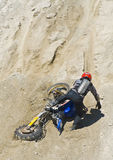 Motorcycle hill climb crash Stock Images