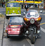 Motorcycle Honda Gold Wing GL1100, bus Volkswagen. BERLIN - MAY 28: Motorcycle Honda Gold Wing GL1100 and minibus Volkswagen Type 2, the exhibition 125 car Royalty Free Stock Images