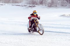 Motorcycle on the ice of the frozen Lake Baikal. Motorcycle on studded tires. Winter Speedway. Extreme bike race in winter. motorcycle on the ice of the frozen royalty free stock image
