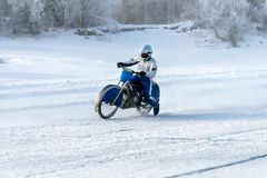 Motorcycle on the ice of the frozen Lake Baikal. Motorcycle on studded tires. Winter Speedway. Extreme bike race in winter. motorcycle on the ice of the frozen royalty free stock photography