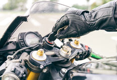 Motorcycle ignition action. Pilot inserting the key and starting the engine Stock Images
