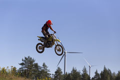 Motorcycle jumper and turbines Stock Photography