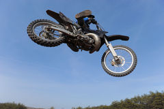 Motorcycle jumping. Photo of motorcycle jumping on a motocross track royalty free stock images