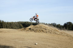 Motorcycle jumping Stock Photo