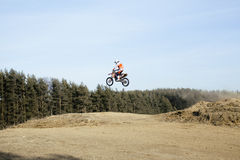 Motorcycle jumping Stock Photography