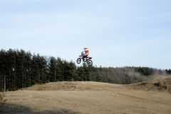 Motorcycle jumping Stock Images