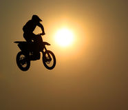 Motorcycle jumps in the air Royalty Free Stock Image