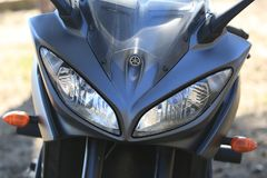 Kawasaki motorcycle. Front fairing with headlights and turn signals Royalty Free Stock Images