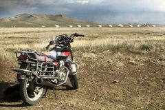 A motorcycle in the landscape of Mongolie Stock Image