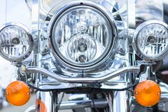 The headlights of a cruiser motorcycle close up royalty free stock images