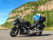 Motorcycle loaded with gear by the road Royalty Free Stock Photo