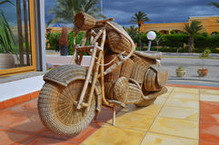 Motorcycle. Made ​​of hand woven wicker and natural size, sold as a souvenir in Tunisia Stock Photography