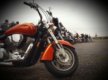 Motorcycle memorial. Line of motorcycles saying goodbye Stock Photography