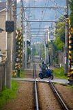 Motorcycle motor bike running cross the railroad at Kamakura royalty free stock images