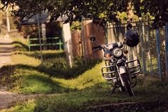 Motorcycle. Motorbike near fence in village Royalty Free Stock Images