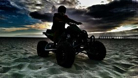 Motorcycle. Motorbike, sunset, beach, sand, helmet Royalty Free Stock Photos