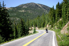 Motorcycle on Mountain Road Royalty Free Stock Photos