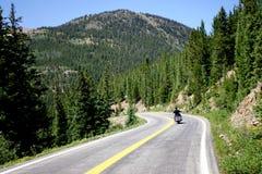 Motorcycle on Mountain Road. In Colorado Rockies Royalty Free Stock Photos