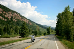 Motorcycle on Mountain Road. In high Rockies, Colorado Royalty Free Stock Image