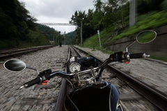 Motorcycle moving on a railroad Stock Photos