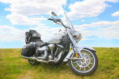 Motorcycle on nature. Classical chromeplated motorcycle on nature royalty free stock images