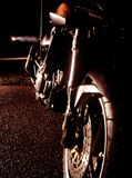 Motorcycle at night. Motorcycle in dark night and light of a    lantern Royalty Free Stock Photo