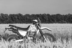Motorcycle off road, enduro, extreme sport, active lifestyle, adventure touring concept, enduro outdoor view sky clouds freedom royalty free stock images