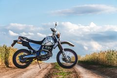 Motorcycle off road, enduro, extreme sport, active lifestyle, adventure touring concept, enduro outdoor view sky clouds freedom stock photography