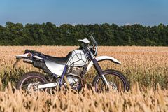 Motorcycle off road, enduro, extreme sport, active lifestyle, adventure touring concept, enduro outdoor view sky clouds freedom stock images