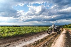 Motorcycle off road, enduro, extreme sport, active lifestyle, adventure touring concept, enduro outdoor view sky clouds freedom royalty free stock photos