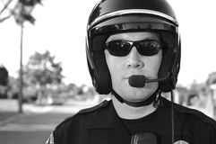 Motorcycle officer. A police motorcycle officer posing for his portrait Stock Photography