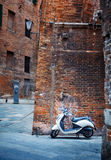 Motorcycle in an old alley of Siena Stock Image